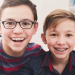 When should I bring my child to an orthodontist for the first time?